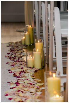 Candles and rose petals are a fantastic way to accent the aisle for your wedding. Photo by Marirosa