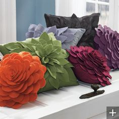 Flower Pillows... Couldn't be very hard to make...