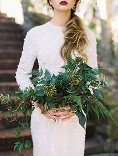 Green Wedding Bouquet: If you want to strictly adhere to a monochromatic emerald green palette, you may hit a snag when you check out traditional bouquets. Skip the blooms and opt for an all-greenery arrangement with dark leaves and fronds representing your chosen shade. | Elegant Emerald Green Wedding Details