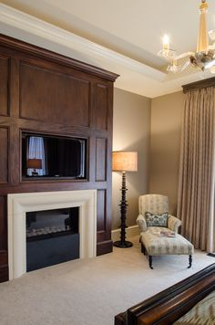 Master Bedroom fireplace with t.v. above ron-farris-french-eclectic