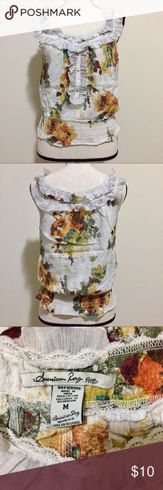 American Rag Boho Tank Blouse Top SZ M This super cute southern belle bohemian styled shirt / top is in great condition. Ruffle lace trimmed neckline. Off white cream colored with a floral pattern. 100% cotton. Elastic waistline. Purchased from Macy's. American Rag Tops Tank Tops