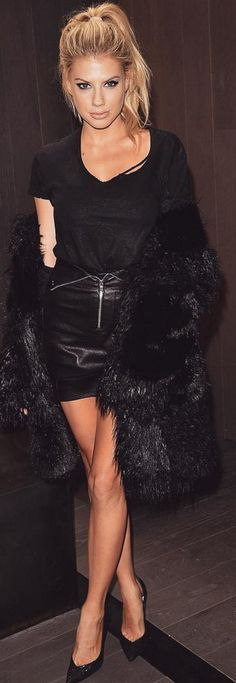 Who made Charlotte Mckinney's black ripped top, leather zipper skirt, and jacket?