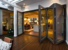 Great idea for shipping containers. Bi-folding doors open up indoor and outdoor space Interiors and outdoor living spaces are best presented when there is continuity. Bi-folding doors is a great way to add practical value & interior design spark. Indoor Outdoor Living, Outdoor Rooms, Outdoor Kitchens, Folding Doors, Folding Glass Patio Doors, Design Case, Wall Design, Glass Design, Design Room
