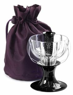 WineWeaver Wine Aerator with FREE Travel Tote [Black Velvet] by Westport MAD. $29.99. Natural aeration to enhance your wine flavors and aromas as you pour. Filters sediment & cork and comes with integrated non-drip stand. Super lightweight design to ensure safe and direct contact on even fine-rimmed glassware. Unique Patented Adjustable Delivery System for use with wine glasses & decanters. Easy to use, Dishwasher safe & for a limited time only comes accompanied by a. BRA...