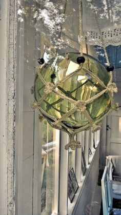 Green glass ball decoration. Scandinavian veranda interior.