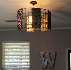 Vintage license plate hanging light. by TinRoofCo on Etsy