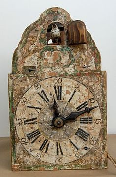 An Ancient Black Forest Wood Wheel Cuckoo Clock with Paper Shield Holtzräder-Kuckucksuhr - This clock was made during the second half of the 18th Century.