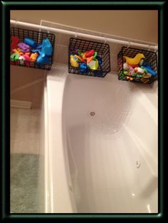 Shower rod+baskets+curtain rings=tub toy organization!!!!