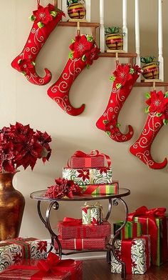 Hang stockings from staircase posts or window ledge, but hang them