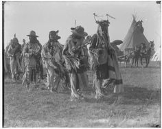 Blackfeet (Pikuni) men - 1905, no names, event or location. Appears to be a men's society ceremony. JE