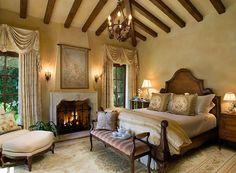 Romantic... love the dark wood headboard, curtains, and dark wood beams on the ceiling