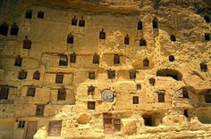 Centuries old manazan vertical cave city is carved out of a sheer rock wall, in the Karaman region of Central Turkey Cave City, Eco Architecture, House On The Rock, Rock Wall, Natural Phenomena, Green Building, Building Ideas, Natural Life, Sustainable Design