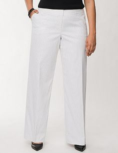 Our Lena fit has curves and knows how to use them in this beautiful pinstripe trouser. Designed for a moderately curvy shape, this polished pinstripe pant offers a sleek, sexy fit in our Tailored Stretch fabric. Classically detailed with four pockets, double bar & slide closure and belt loops. Fully lined for an amazing drape and no show-through. lanebryant.com