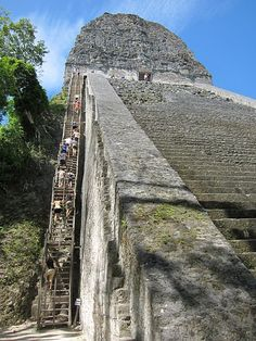Tikal, Guatemala; this is what is like as a kid, looking up the steps of the temple...no wooden ladders back then.