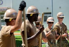 OKINAWA, Japan (July 28, 2015) Builder Constructionman Miranda Vierra, a Seabee assigned to Naval Mobile Construction Battalion (NMCB) 5, talks about a concrete placement for a bicycle parking area at Camp Shields, Okinawa.