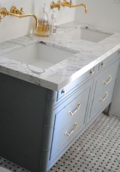 marble basketweave floor, marble vanity top. Hate the gold fixtures though, sorry.