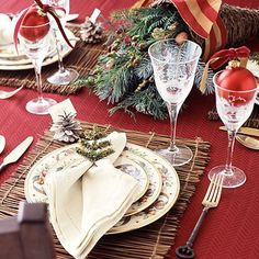Red tablecloth, natural twig placemats & Christmas dishes ... with evergreen centerpiece