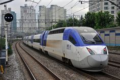 South Korea's KTX 2 ::: Built by Hyundai Rotem, the KTX-II was the first commercial high-speed train developed in South Korea. Seen here along the Gyeongbu line, the rail has been in service since 2010, and can travel at 190 mph.