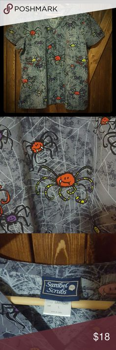 SALE! Cute Spiders Halloween Scrub Top Super cute Large Sanibel Scrubs multicolor spider print scrub top. Perfect for Halloween! 2 front pockets to hold your pens/phone/notepad or whatever else you need to carry!   *** DISCLAIMER. *** ???????? I worked in an animal shelter. All scrubs have been washed and pressed but some dander may still exist. Sanibel Scrubs Tops