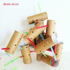 DIY CONSTRUCTION: Paper towel / toilet paper rolls + a hole punch + bendy straws = some serious fine motor construction fun!