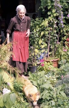 """Tasha Tudor, an American illustrator of children's books. She lived — a 19th century life — depicted in her books: """"She wore kerchiefs, hand-knitted sweaters, fitted bodices and flowing skirts. She reared her four children in a home without electricity or running water until her youngest turned five…"""" She raised her own farm animals; turned flax she had grown into clothing; and lived by homespun wisdom: sow root crops on a waning moon, above-ground plants on a waxing one."""""""