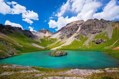 One Colorado destination known for its jaw-dropping beauty is Island Lake in Southwest Colorado near Silverton. Tucked away in the San Juan National Forest, Island Lake is one of four bright blue lakes that hikers trek to in the Upper Ice Lake Basin. It's a four-mile trail one way, but it's definitely worth it, as hikers make the journey past old mining ruins, seemingly endless wildflower fields, and jagged peak after jagged peak.