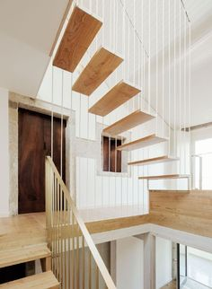 arrokabe arquitectos fits light-framed staircase to home renovation in spain
