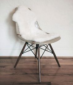 Real Sheepskin Covers for Eames Style Shell Chairs. $78.00, via Etsy.