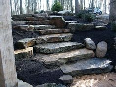 Natural stone landscaping including patios, walkways, firepits, walls and more. Aching Acres serves your midwest residential landscaping contractor needs. Landscaping A Slope, Residential Landscaping, Landscaping Retaining Walls, Landscaping Ideas, Landscape Design, Garden Design, Hillside Garden, Garden Paths, Garden Stairs