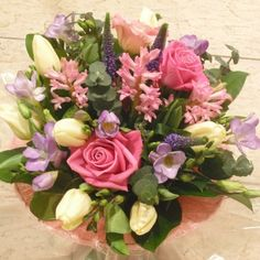 A scented bouquet with Stocks and Freesias complemented with pink Roses, white Tulips, Veronica and foliages.  Part of our Mothers Day 2016 Collection.