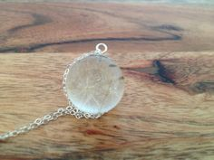 Dandelion fluff clear resin orb with a silver flower bead cap on Etsy, $28.00