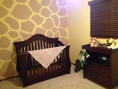 Giraffe Nursery. I think Sean would kill me if I asked to paint a wall like this in the nursery! Lol