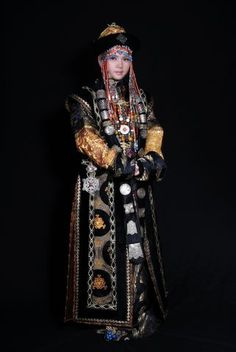 China | woman in one of the traditional costumes from Mongolia.