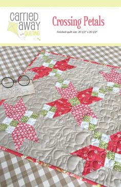 """Crossing Petals Mini Quilt Pattern Designer Taunja Kelvington of Carried Away Quilting - Size 20 1/2"""" x 20 1/2 """" Materials Needed: Green 1/9 yd, Neutral 1/9 yd, Red #1 1/6 yd, Red #2 1/6 yd, Tan 1/3 y"""