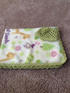 Fleece baby blanket with crocheted edge and matching hat.