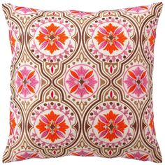 Vivid colors lend modern appeal to this vintage-inspired Jennifer Paganelli embroidered pillow. The pink, brown and orange medallion design of the Back Bay pillow adds texture and interest when mixed with other colors and patterns.