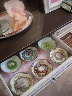 We can never have too many ideas when it comes to organizing and displaying jewelry. If you're not short on storage space, reserve a vanity or dresser drawer just for holding bracelets, necklaces and rings. Designer Lynda Quintero-Davids wanted to add as much style and function to her client's dressing table, so she incorporated antique china teacups and soup bowls into one of the lined drawers. Each dish serves as a perfect way to separate small pieces like rings, earrings and brooches.