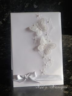 handmade card from Bodhicea's Designs: White Vellum Butterfly Card … delightful white on white … cloud of butterflies rising to the skies . pearls and satin ribbon … luv it! Baptism Cards, Parchment Cards, Butterfly Cards, Butterfly Wedding, White Butterfly, Wedding Anniversary Cards, Card Wedding, Happy Anniversary, Engagement Cards