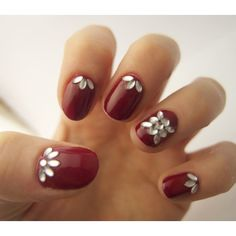 Nail Art Idea: Jewels Paint a deep red base, let dry, and then add crystals in a half moon shape using nail glue and a pair of tweezers (or stickers). Finish with a topcoat to secure stones.