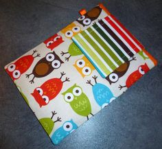 Kindle/Kobo/eReader Cover Sleeve Handmade in Robert Kaufman Urban Zoologie Owl Fabric and Multi-coloured Stripes. $20.00, via Etsy.