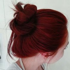 Dark red hair with a copper tone! I would love this color with a few blonde pieces through it.