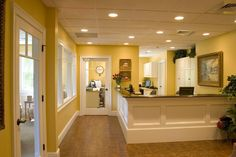 Cheery reception area with white trim.