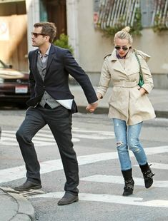 LOVE the edgy boots and classic trench combo…and is he wearing a vest?! super love!