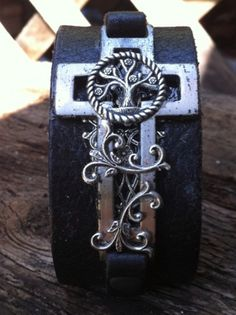 Fantasy Celtic Christian cross and tree of life cuff in leather, pewter, and silver plate. $39