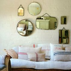 mirror gallery wall and grain sack pillows; Old Mirrors, Vintage Mirrors, Mirror Mirror, Hanging Mirrors, Mirror Ideas, Mirror Walls, Retro Mirror, Large Mirrors, Vintage Decor