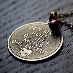 "this necklace just stole my heart <3  ""I love you more than yesterday, less than tomorrow"""