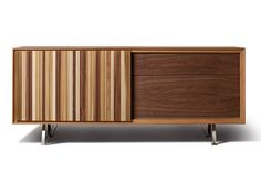 SIPARIO, sideboard made of cherry wood and canaletto walnut with one sliding door and three push&pull drawers. Design by MAAM