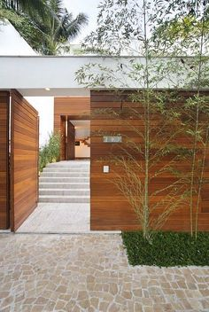 Side entry. Like - Solid in appearance and fortified, not flimsy or delicate. Façade above the gate creates illusion of entry to a property than a side entrance. Sets the quality that continues beyond.