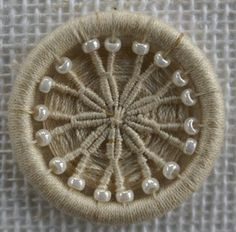 6/18 32mm button worked in the Daisy design and seed beads. Henry's Buttons for Dorset Buttons - Gallery