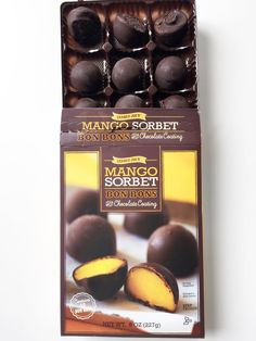 Do yourself a favor and get these chocolate-covered mango sorbet bon bons. The slight bitterness of the thin dark chocolate coating is the ultimate match for Chocolate Coating, Chocolate Covered, Frozen Desserts, Frozen Treats, Candy Recipes, Gourmet Recipes, Homemade Beans, Popsugar Food, Food Picks